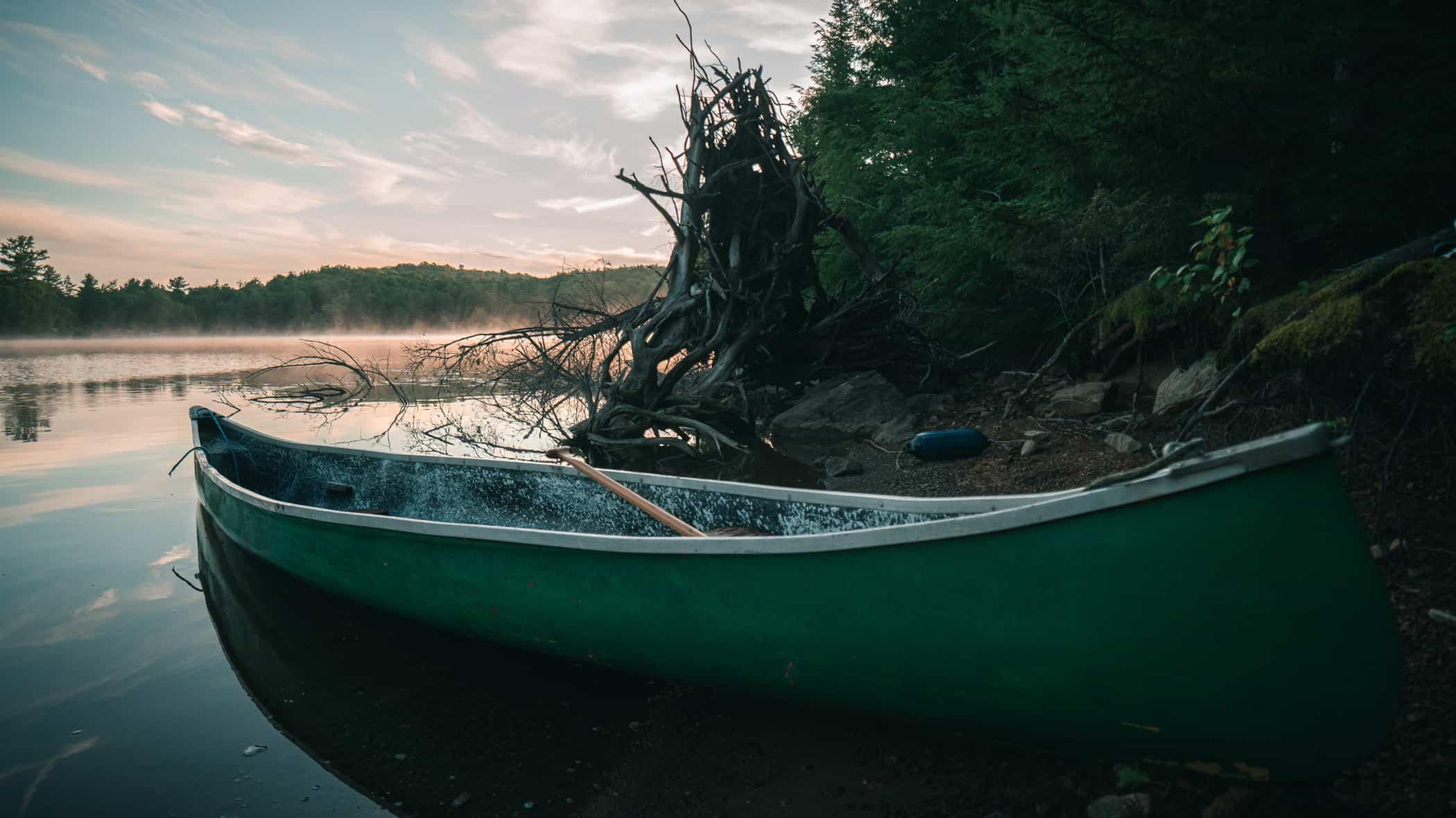 canoe on lake - Derek Sutton